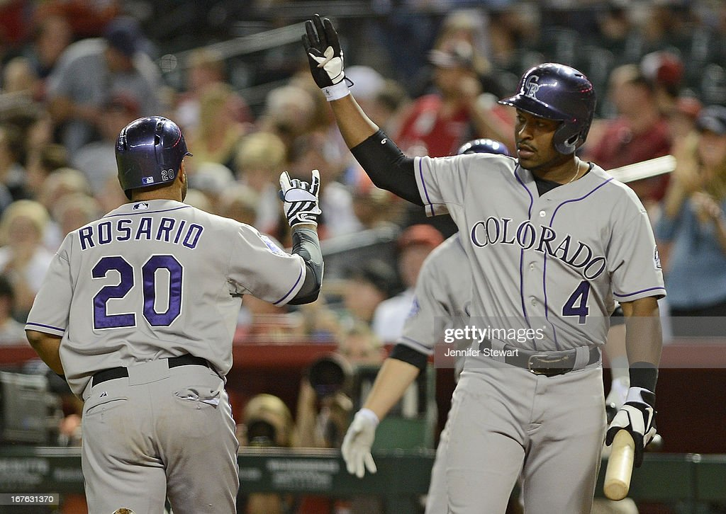 <a gi-track='captionPersonalityLinkClicked' href=/galleries/search?phrase=Wilin+Rosario&family=editorial&specificpeople=5734314 ng-click='$event.stopPropagation()'>Wilin Rosario</a> #20 of the Colorado Rockies is congratulated by teammate Chris Nelson #4 after hitting a solo home run against the Arizona Diamondbacks in the sixth inning at Chase Field on April 26, 2013 in Phoenix, Arizona.