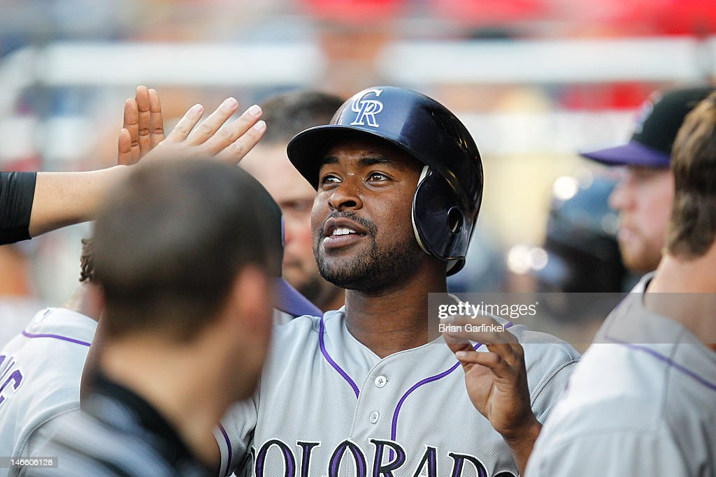 Wilin Rosario #20 of the Colorado Rockies is congratulated by teammates in the dugout after hitting a three run home run in the second inning of the game against the Philadelphia Phillies at Citizens Bank Park on June 20, 2012 in Philadelphia, Pennsylvania.