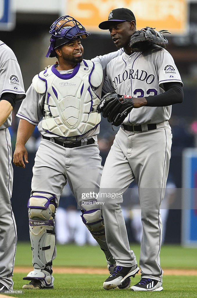 Wilin Rosario of the Colorado Rockies left congratulates LaTroy Hawkins after beating the San Diego Padres 31 in a baseball game at Petco Park April...