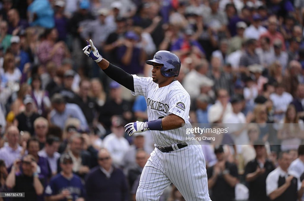 Wilin Rosario (20) of the Colorado Rockies rounds the bases after hitting a home run in the fourth inning. The Colorado Rockies took on the San Diego Padres on Opening Day at Coors Field in Denver, Colorado.