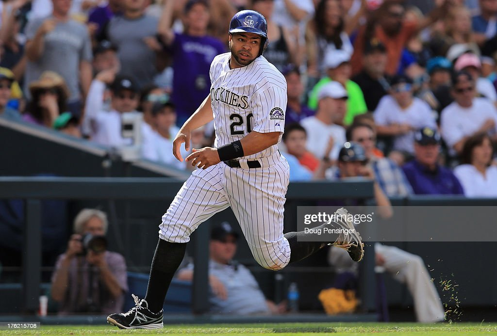 <a gi-track='captionPersonalityLinkClicked' href=/galleries/search?phrase=Wilin+Rosario&family=editorial&specificpeople=5734314 ng-click='$event.stopPropagation()'>Wilin Rosario</a> #20 of the Colorado Rockies runs home to score the game winning run on a double by Nolan Arenado #28 of the Colorado Rockies off of Bryan Morris #29 of the Pittsburgh Pirates in the seventh inning at Coors Field on August 11, 2013 in Denver, Colorado. The Rockies defeated the Pirates 3-2.