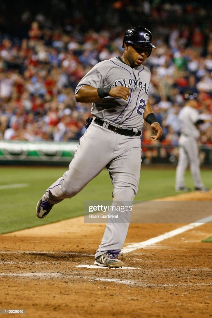 Wilin Rosario #20 of the Colorado Rockies scores a run in the ninth inning to take the lead against the Philadelphia Phillies at Citizens Bank Park on June 20, 2012 in Philadelphia, Pennsylvania.