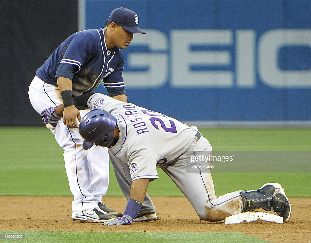<a gi-track='captionPersonalityLinkClicked' href=/galleries/search?phrase=Wilin+Rosario&family=editorial&specificpeople=5734314 ng-click='$event.stopPropagation()'>Wilin Rosario</a> #20 of the Colorado Rockies tangles with <a gi-track='captionPersonalityLinkClicked' href=/galleries/search?phrase=Everth+Cabrera&family=editorial&specificpeople=5743470 ng-click='$event.stopPropagation()'>Everth Cabrera</a> #2 of the San Diego Padres as he slides safely into second base during the third inning of a baseball game at Petco Park on April 13, 2013 in San Diego, California.