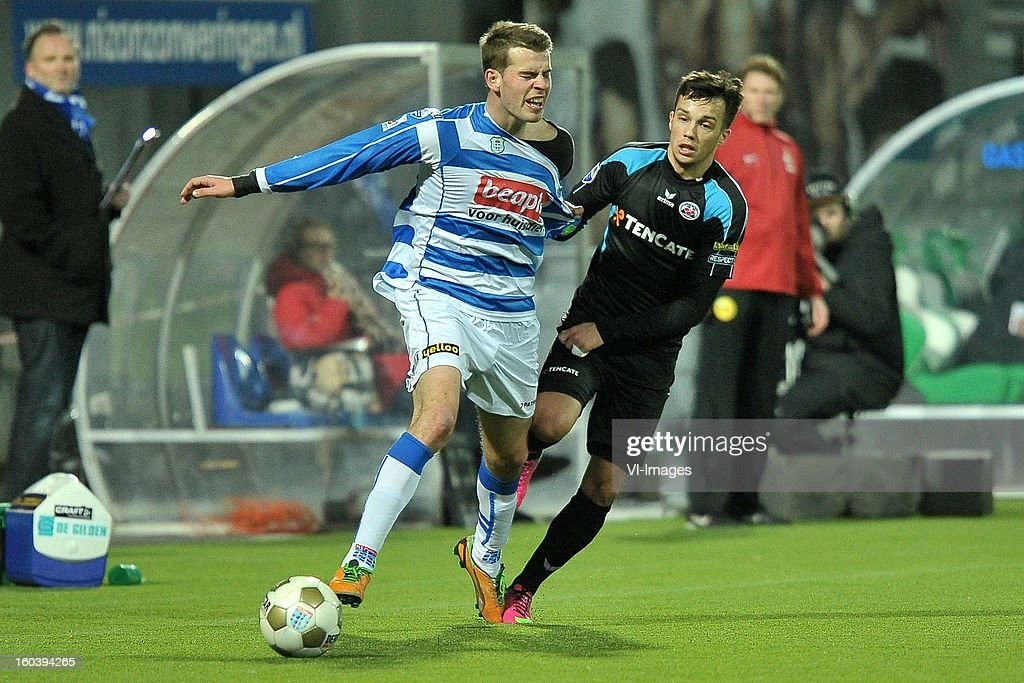 Wiljan Pluim of PEC Zwolle, Dario Vujicevic of Heracles Almelo during the Dutch Cup match between PEC Zwolle and Heracles Almelo at the IJsseldelta Stadium on january 30, 2013 in Zwolle, The Netherlands
