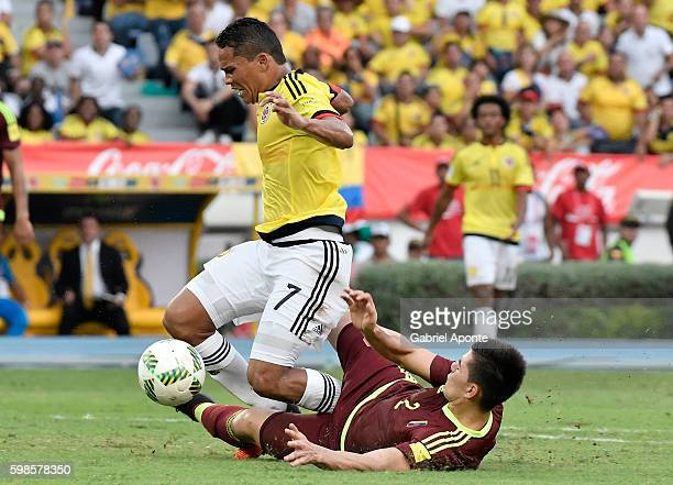 Wilker Angel of Venezuela makes a penalty foul over Carlos Bacca of Colombia during a match between Colombia and Venezuela as part of FIFA 2018 World...