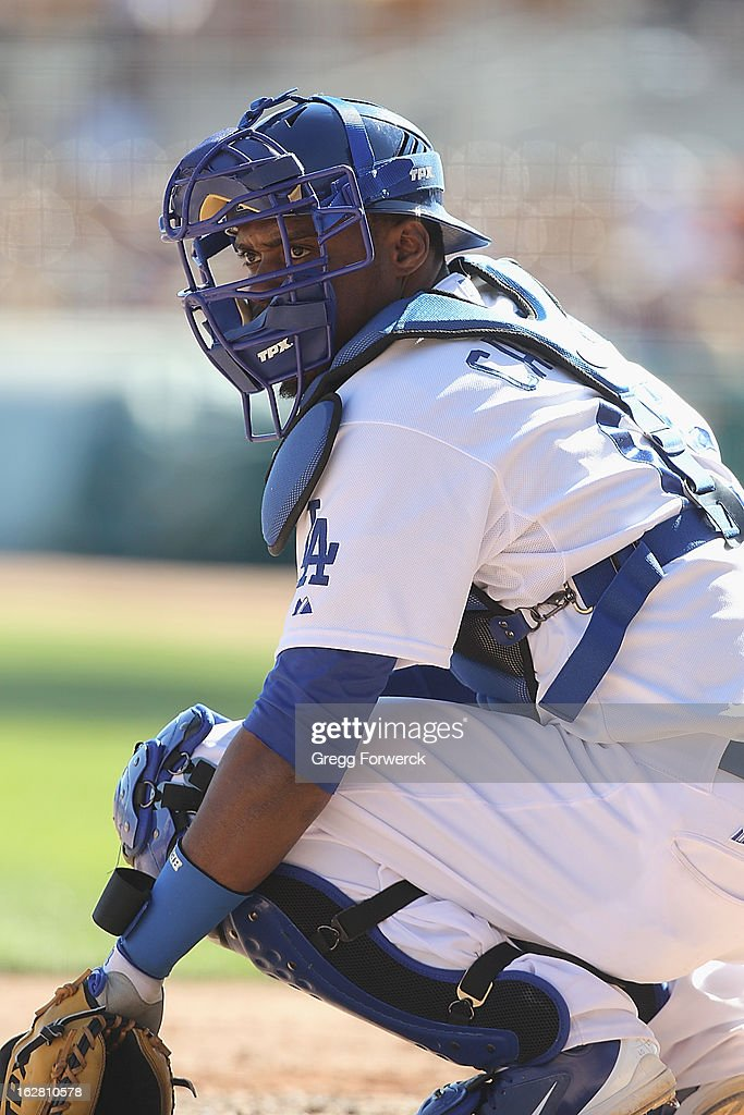 Wilkin Castillo of the Los Angeles Dodgers gets signs from the dugout during a spring training baseball game against the San Francisco Giants at Camelback Ranch on February 26, 2013 in Glendale, Arizona.
