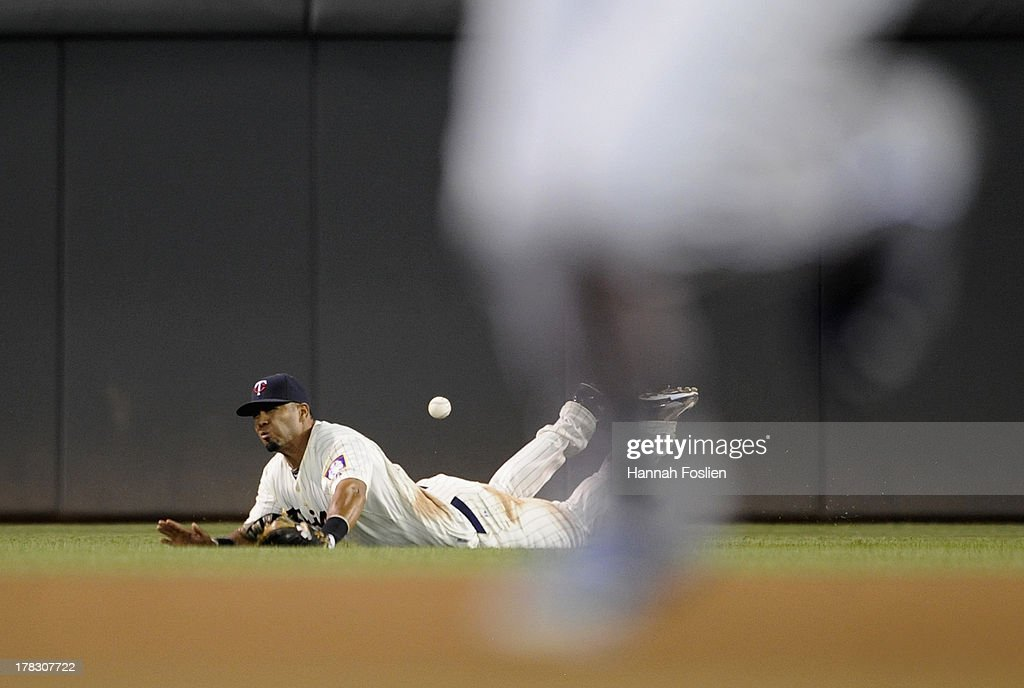Wilkin Ramirez #22 of the Minnesota Twins misses a catch of the RBI single hit by Billy Butler #16 of the Kansas City Royals as his teammate <a gi-track='captionPersonalityLinkClicked' href=/galleries/search?phrase=Eric+Hosmer&family=editorial&specificpeople=7091345 ng-click='$event.stopPropagation()'>Eric Hosmer</a> #35 rounds the bases during the eighth inning of the game on August 28, 2013 at Target Field in Minneapolis, Minnesota. The Royals defeated the Twins 8-1.