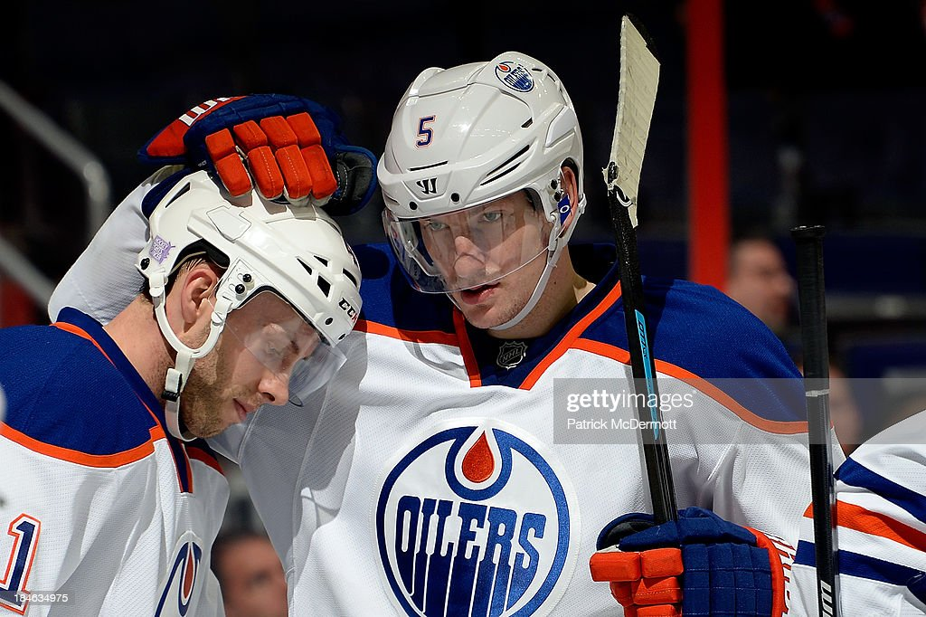 <a gi-track='captionPersonalityLinkClicked' href=/galleries/search?phrase=Will+Acton&family=editorial&specificpeople=8317872 ng-click='$event.stopPropagation()'>Will Acton</a> #41 of the Edmonton Oilers celebrates with Ladislav Smid #5 after scoring a goal in the third period against the Washington Capitals during an NHL game at Verizon Center on October 14, 2013 in Washington, DC.