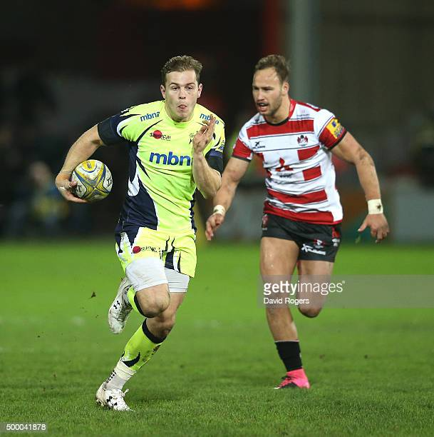 Will Addison of Sale breaks clear of Bill Meakes during the Aviva Premiership match between Gloucester and Sale Sharks at Kingsholm on December 4...