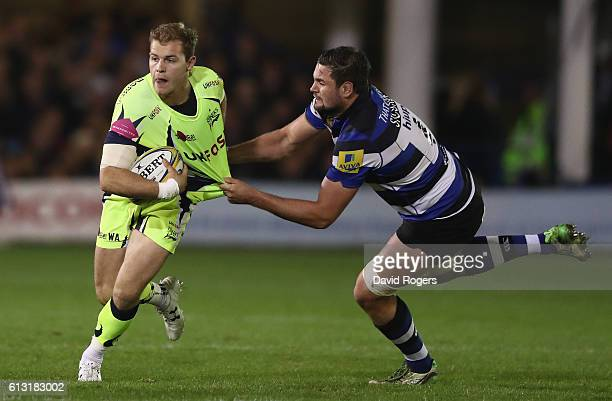 Will Addison of Sale is held by Elliott Stooke during the Aviva Premiership match between Bath Rugby and Sale Sharks at the Recreation Ground on...
