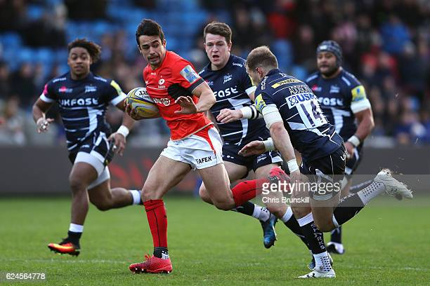 Will Addison of Sale Sharks chases Alex Lozowski of Saracens during the Aviva Premiership match between Sale Sharks and Saracens at the AJ Bell...