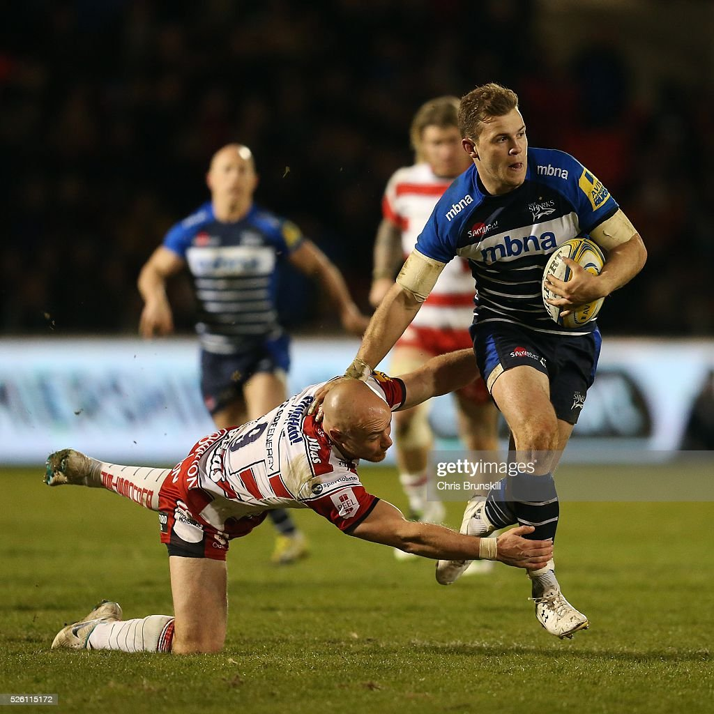 Will Addison of Sale Sharks is tackled by Willi Heinz of Gloucester Rugby during the Aviva Premiership match between Sale Sharks and Gloucester Rugby at the AJ Bell Stadium on April 29, 2016 in Salford, England.