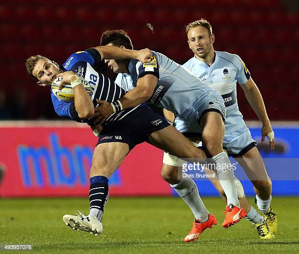Will Addison of Sale Sharks is tackled by Wynand Olivier of Worcester Warriors during the Aviva Premiership match between Sale Sharks and Worcester...