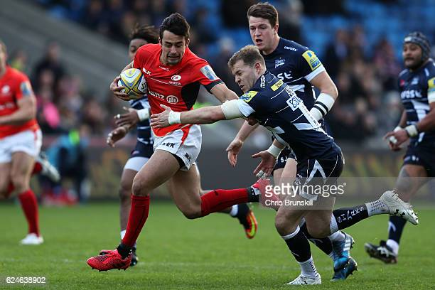 Will Addison of Sale Sharks tackles Alex Lozowski of Saracens during the Aviva Premiership match between Sale Sharks and Saracens at the AJ Bell...