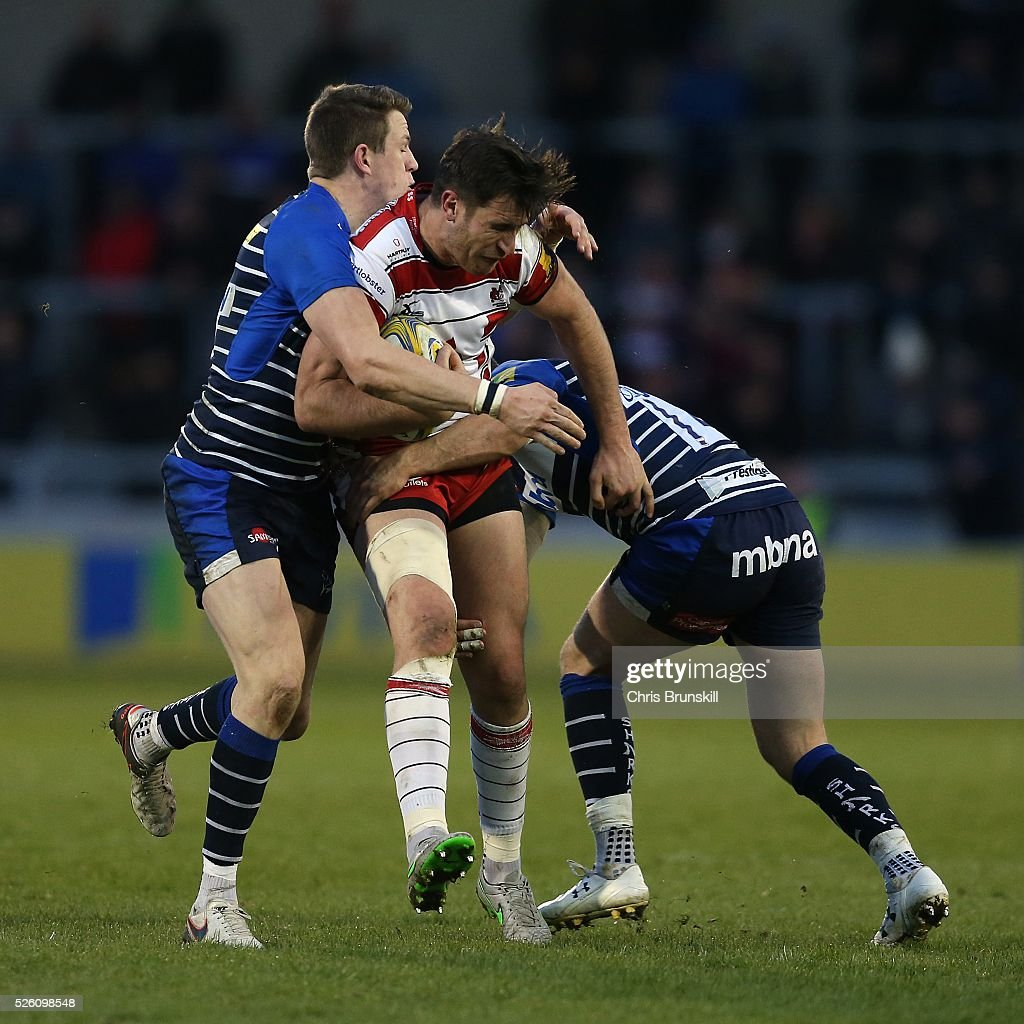 Will Addison of Sale Sharks tackles Mark Atkinson of Gloucester Rugby during the Aviva Premiership match between Sale Sharks and Gloucester Rugby at the AJ Bell Stadium on April 29, 2016 in Salford, England.