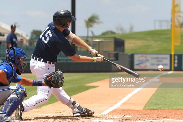 Will Allen of the Flying Tigers puts the bat on the ball as he lines the ball up the middle during the Florida State League game between the Dunedin...