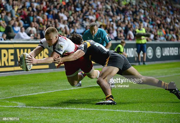 Will Allman of Northampton Saints scores a try as he is tackled by Conor Dolan of Wasps during the Singha Premiership Rugby 7s Series Coventry at...