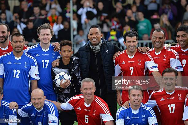 Will and Jaden Smith pose with former players at the UEFA's Champions Festival which comes to London to coincide with Wembley hosting the Champions...