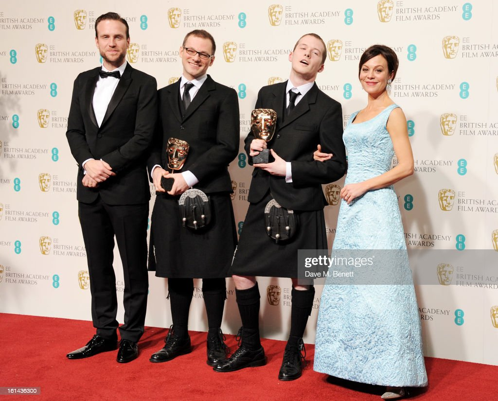 Will Anderson (2L) and Ainslie Henderson (2R), winners of the Short Animation awards for 'The Making Of Longbird', pose in the press room with presenters Helen McCrory and Rafe Spall in the Press Room at the EE British Academy Film Awards at The Royal Opera House on February 10, 2013 in London, England.