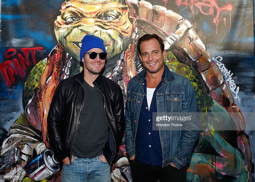 Will Arnett and Stephen Amell pose at Bondi beach during a photo call ahead of the Australian premiere of Teenage Mutant Ninja Turtles 2 on May 28, 2016 in Sydney, Australia.