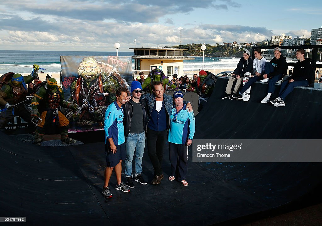 Will Arnett and Stephen Amell pose with Bondi lifeguards at Bondi beach during a photo call ahead of the Australian premiere of Teenage Mutant Ninja Turtles 2 on May 28, 2016 in Sydney, Australia.