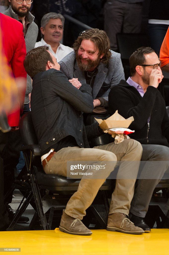 Will Arnett (L) and Zach Galifianakis attend a basketball game between the Minnesota Timberwolves and Los Angeles Lakers at Staples Center on February 28, 2013 in Los Angeles, California.