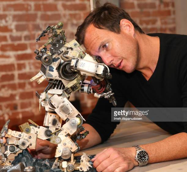 Will Arnett gets up close and personal with a Titan while previewing Titanfall on Xbox One at the Microsoft Lounge on February 24 2014 in Venice...