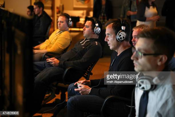 Will Arnett tests out the multiplayer action of Titanfall on Xbox One at the Microsoft Lounge on February 24 2014 in Venice California