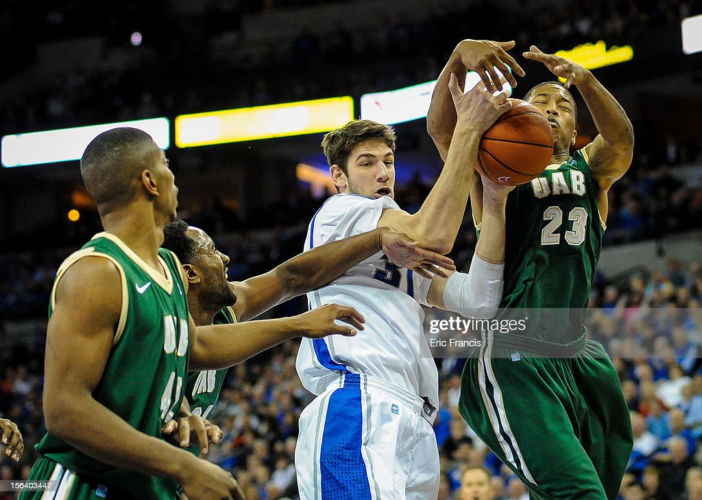 Will Artino #31 of the Creighton Bluejays battles with Isiah Jones #23 of the UAB Blazers for a rebound during their game at CenturyLink Center on November 14, 2012 in Omaha, Nebraska.