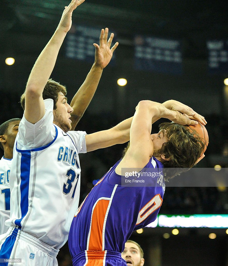 Will Artino #31 of the Creighton Bluejays blocks the shot of Ryan Sawvell #0 of the Evansville Aces during their game at the CenturyLink Center on December 29, 2012 in Omaha, Nebraska.