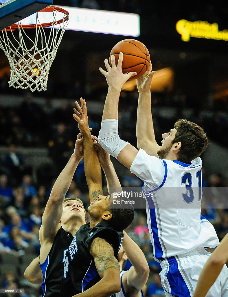 Will Artino #31 of the Creighton Bluejays grabs a rebound over Khalid Mutakabbir #24 and Ryan McTavish #20 of the Presbyterian Blue Hose during their game at CenturyLink Center on November 18, 2012 in Omaha, Nebraska.