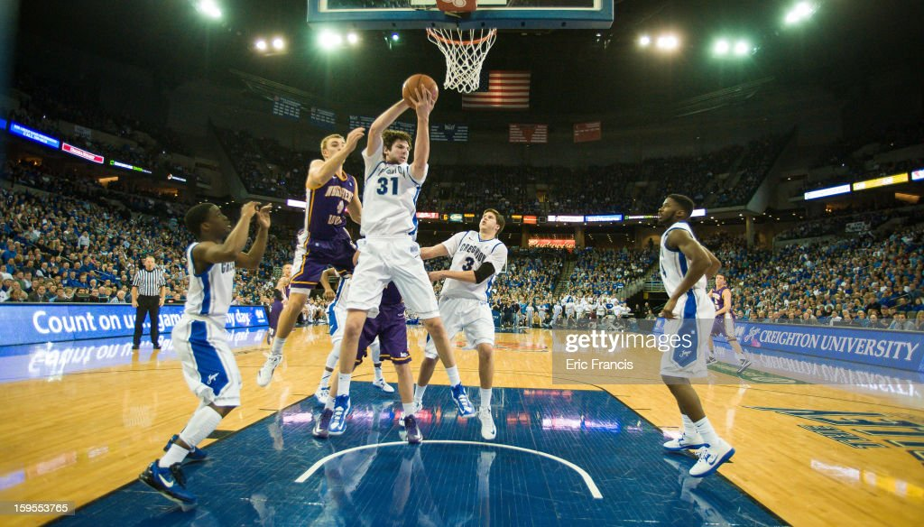 Will Artino #31 of the Creighton Bluejays pulls in a rebound over Chip Rank #4 of the Northern Iowa Panthers during their game at the CenturyLink Center on January 15, 2013 in Omaha, Nebraska.