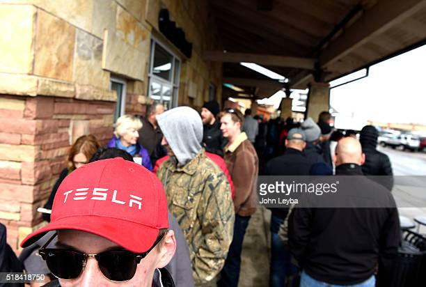 Will Aversion 19 years old a student at University of Denver stands in line with other Tesla fans at Park Meadows Mall March 31 2016 to preorder the...