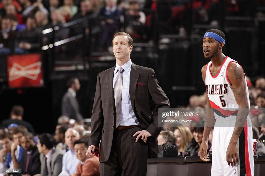 Will Barton #6 and Head Coach Terry Stotts of the Portland Trailblazers have a conference against the Los Angeles Clippers in a game on January 26, 2013 at the Rose Garden Arena in Portland, Oregon.
