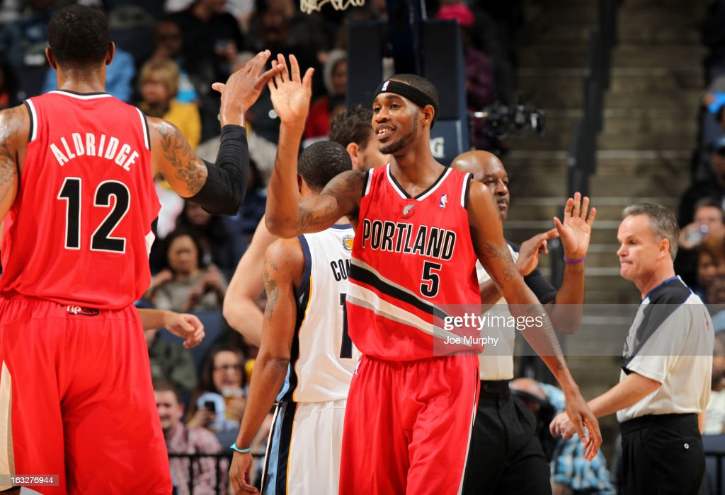 Will Barton #5 and LaMarcus Aldridge #12 of the Portland Trail Blazers celebrate during a game against the Memphis Grizzlies on March 6, 2013 at FedExForum in Memphis, Tennessee.