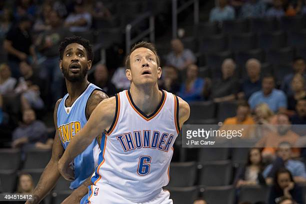 Will Barton of the Denver Nuggets and Steve Novak of the Oklahoma City Thunder during the fourth quarter of a NBA preseason game at the Chesapeake...