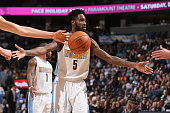 Will Barton of the Denver Nuggets celebrates a made free throw with teammates against the Houston Rockets at Pepsi Center on December 14 2015 in...