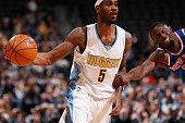 Will Barton of the Denver Nuggets controls the ball against Jerian Grant of the New York Knicks at Pepsi Center on March 8 2016 in Denver Colorado...