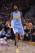Will Barton of the Denver Nuggets dribbles the ball against the Golden State Warriors during an NBA basketball game at ORACLE Arena on January 2 2016...