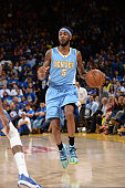 Will Barton of the Denver Nuggets drives against the Golden State Warriors on April 15 2015 at Oracle Arena in Oakland California NOTE TO USER User...