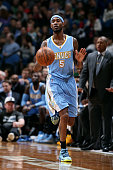Will Barton of the Denver Nuggets drives against the Minnesota Timberwolves on March 4 2015 at Target Center in Minneapolis Minnesota NOTE TO USER...