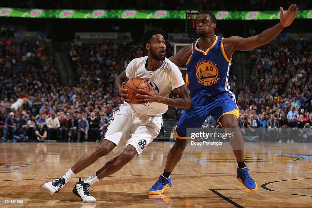 Will Barton of the Denver Nuggets drives to the basket against Harrison Barnes of the Golden State Warriors at Pepsi Center on January 13 2016 in...