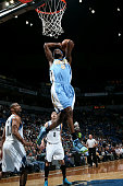 Will Barton of the Denver Nuggets dunks against the Minnesota Timberwolves on March 4 2015 at Target Center in Minneapolis Minnesota NOTE TO USER...