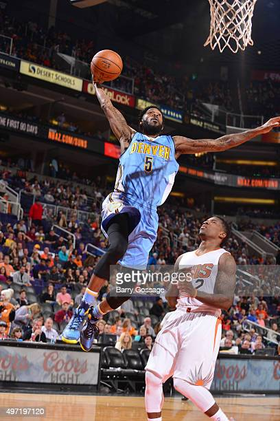 Will Barton of the Denver Nuggets dunks against the Phoenix Suns during the game on November 14 2015 at Talking Stick Resort Arena in Phoenix Arizona...