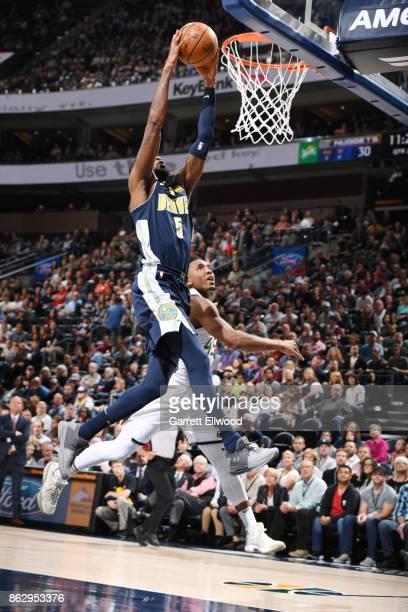 Will Barton of the Denver Nuggets dunks against the Utah Jazz during the game on October 18 2017 at vivintSmartHome Arena in Salt Lake City Utah NOTE...
