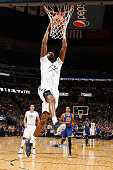Will Barton of the Denver Nuggets dunks the ball against the Golden State Warriors at Pepsi Center on November 22 2015 in Denver Colorado The...