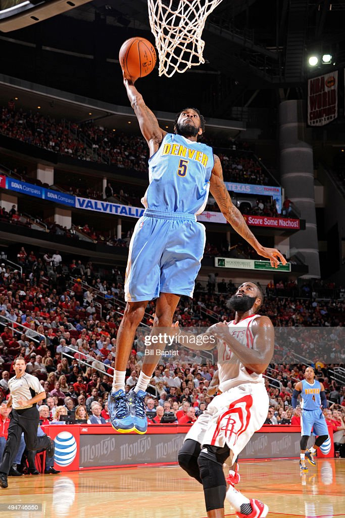 Will Barton of the Denver Nuggets dunks the ball against the Houston Rockets on October 28 2015 at the Toyota Center in Houston Texas NOTE TO USER...