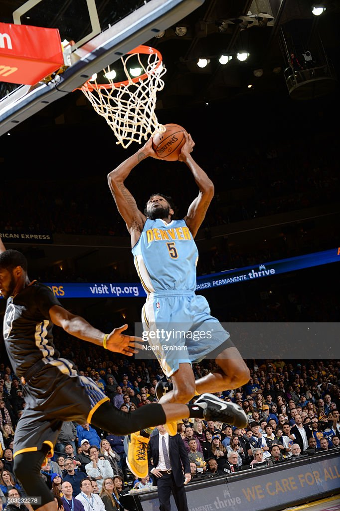 Will Barton of the Denver Nuggets goes for the dunk during the game against the Golden State Warriors on January 2 2016 at ORACLE Arena in Oakland...