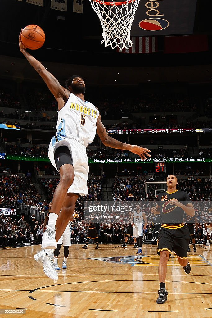 Will Barton of the Denver Nuggets goes up for a dunk against Richard Jefferson of the Cleveland Cavaliers at Pepsi Center on December 29 2015 in...