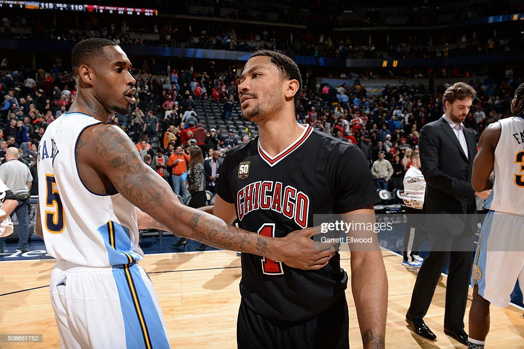 Will Barton of the Denver Nuggets greets Derrick Rose of the Chicago Bulls after the game on February 5 2016 at the Pepsi Center in Denver Colorado...